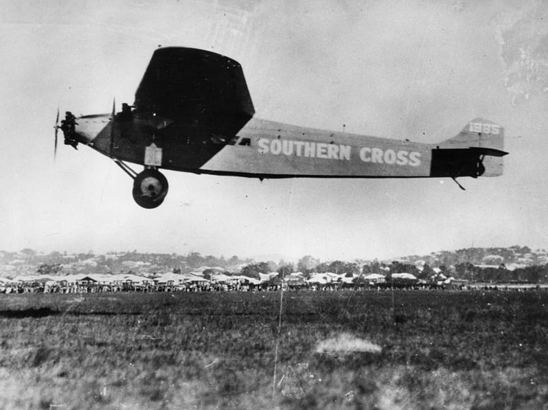 The Southern Cross in flight over the airfield