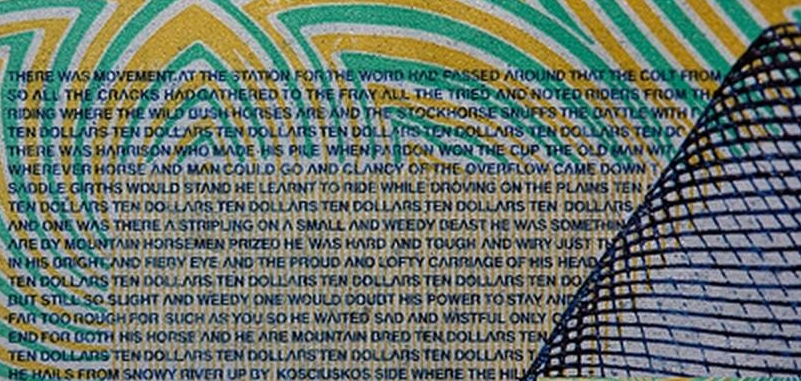Detailed close up  of the micro printing on the ten dollars banknote showing the words to 'The Man From Snowy River'.